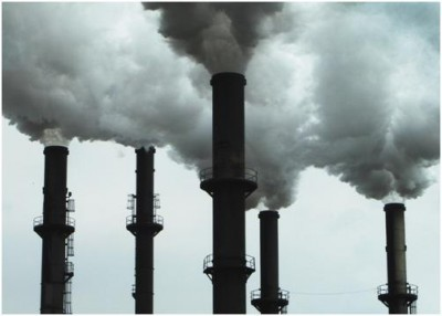 Industrial waste being spewed into the atmosphere from a factory